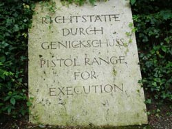 Marker for mass grave in Dachau concentration camp